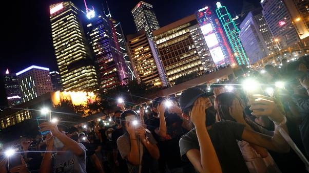 People hold their lit up smartphones during a students' rally to call for political reforms outside City Hall in Hong Kong, China, August 22, 2019