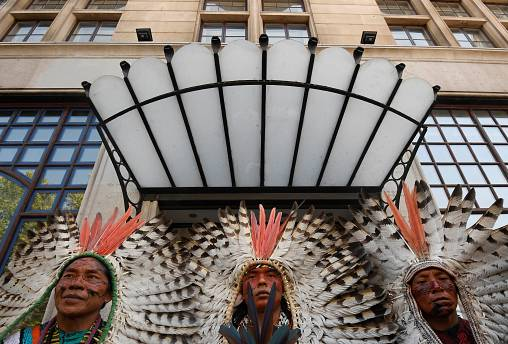 Indigenous protesters and environmental activists call to protect rainforest
