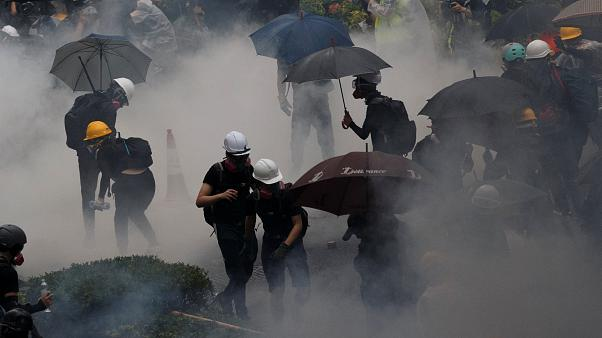Anti-extradition bill protesters are surrounded by tear gas during clashes with police in Tsuen Wan in Hong Kong, China August 25, 2019. Picture taken August 25, 2019.