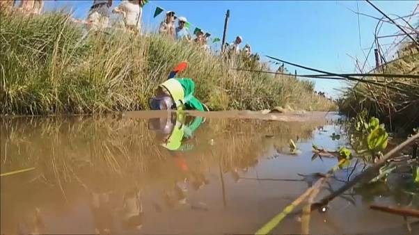 Competitors complete two lengths of a trench cut through a peat bog