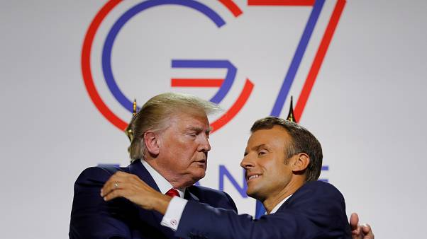 French President Emmanuel Macron greets U.S. President Donald Trump after a joint press conference at the end of the G7 summit in Biarritz, France, August 26, 2019.