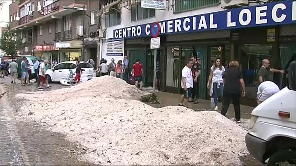Mountains of hail outside local market in Arganda del Rey near Madrid