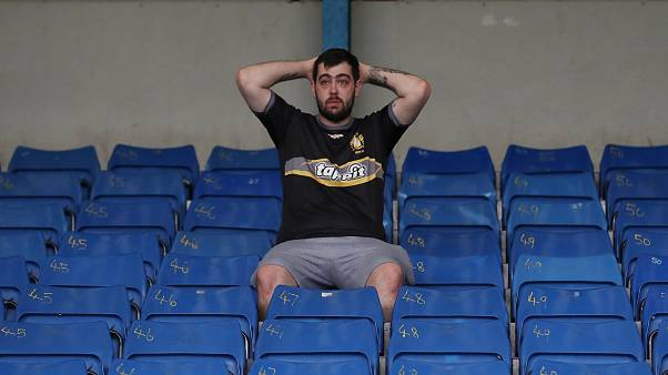 Bury fan, at their ground Gigg lane, after finding out their takeover deal fell through