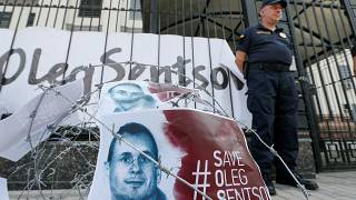 Barbed wire and placards with images of Ukrainian film director Oleg Sentsov are seen after a rally demanding the release of Sentsov