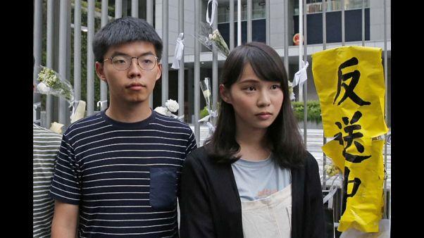 Joshua Wong & Andy Chow attivisit di Pro Democracy arrestati dalla polizia di Hong Kong