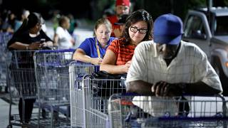 Shoppers wait in line for a Sam's Club store to open before sunrise, as people rushed to buy supplies ahead of the arrival of Hurricane Dorian in Kissimmee, Florida, U.S.