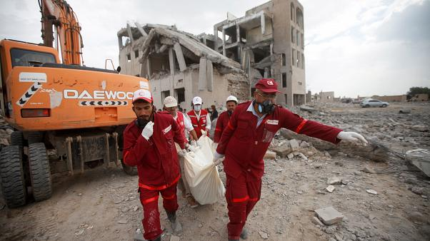Red Crescent medics carry a body of the victim of Saudi-led airstrikes on a Houthi detention centre in Dhamar, Yemen, September 1, 2019.