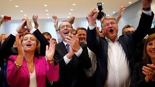 AfD candidates celebrate exit polls showing predicted gains in share of vote.