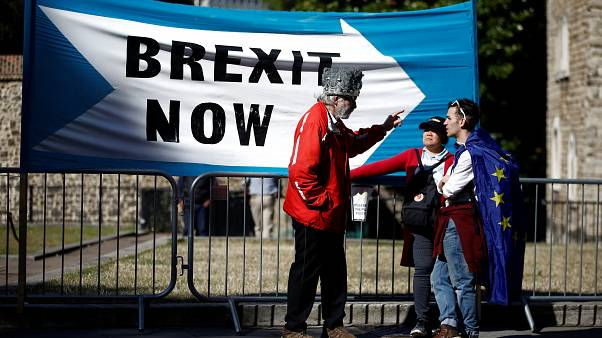 A Pro-Brexit protester talks with anti-Brexit protesters in London, Britain, September 2, 2019.