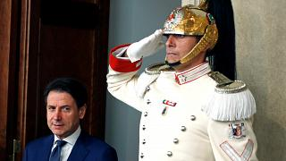 Italian Prime Minister Giuseppe Conte arrives to speak to the media after meeting with Italian President Sergio Mattarella