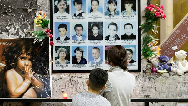 People attend a memorial ceremony marking the 15th anniversary of the deadly school siege in the town of Beslan, Russia September 1, 2019.