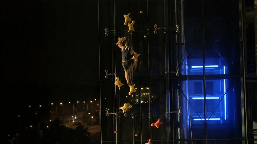 Polish speed climber beats lift in neon night race