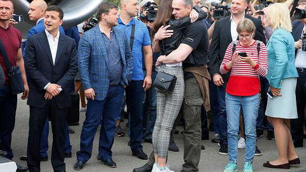 Emotional scenes as Ukraine president welcomes home freed prisoners