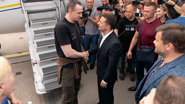 Ukrainian President Volodymyr Zelenskiy welcomes film director Oleg Sentsov, at Borispil International Airport, outside Kiev, Ukraine September 7, 2019.