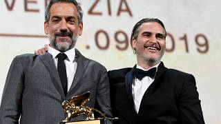 Director Todd Phillips poses next to Joaquin Phoenix after winning the Golden Lion for Best Film in Venice, Italy on September 7, 2019.