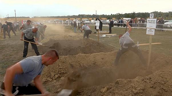 How do you dig the perfect grave? Hungarian gravediggers will show you
