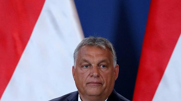 Hungarian Prime Minister Viktor Orban reacts during a news conference with German Chancellor Angela Merkel (not pictured) as they visit the Hungarian border town of Sopron.