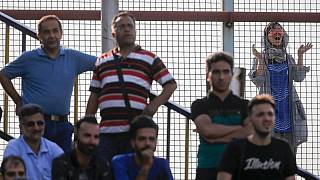 A female fan looks on as an Esteghlal FC game is underway