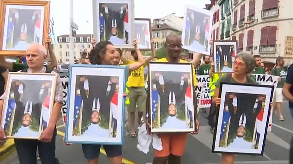 Watch: Climate protesters on trial over Macron portraits