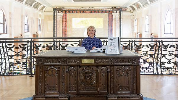 Clinton posed at a replica of the Oval Office's desk