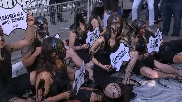 PETA activists doused themselves in black slime to highlight 'hazardous waste associated with the leather industry'