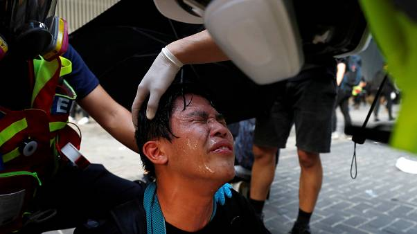 Anti-government cleans his eyes after tear gas was fired by the riot police during a demonstration near Central Government Complex in Hong Kong, China, September 15, 2019.