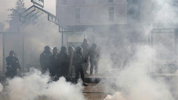 Tear gas floats in the air as protesters clash with French gendarme during a demonstration of the yellow vests movement in Nantes on September 14