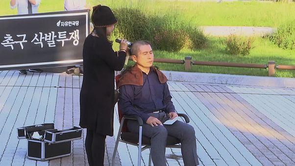 رهبر مخالف دولت کرهجنوبی موهای خود را در اعتراض به وزیر دادگستری تراشید