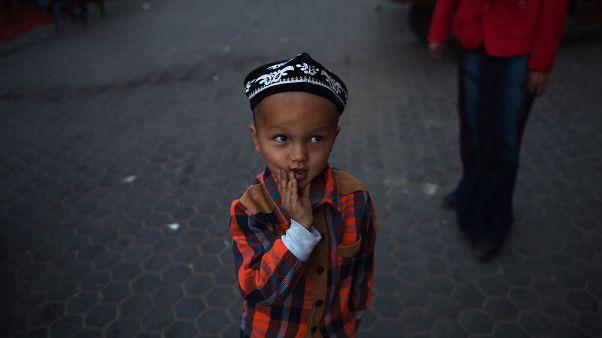 Doğu Türkistan'ın Hoten kentinde bir Uygur çocuk / 2015
