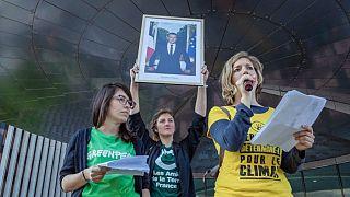 Alternatiba activists with a portrait of French president Emmanuel Macron they've taken down, April 19, 2019.