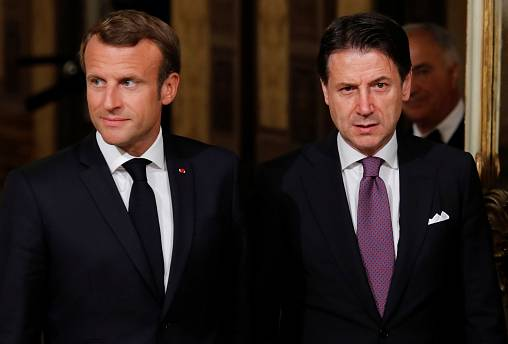 Emmanuel Macron and Giuseppe Conte talk migration policy in Rome