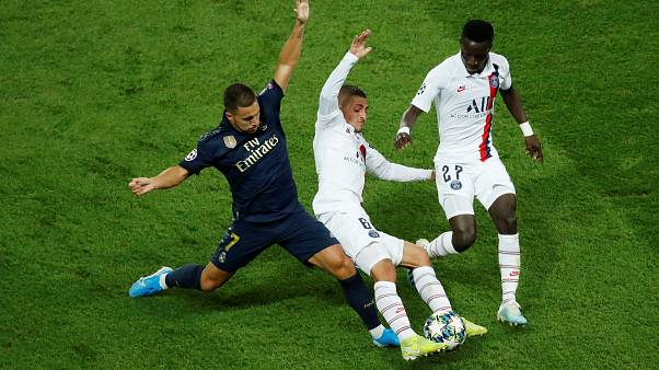 Real Madrid's Eden Hazard in action with Paris St Germain's Marco Verratti and Idrissa Gueye