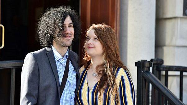 Emma DeSouza and her husband Jake outside the Upper Tribunal