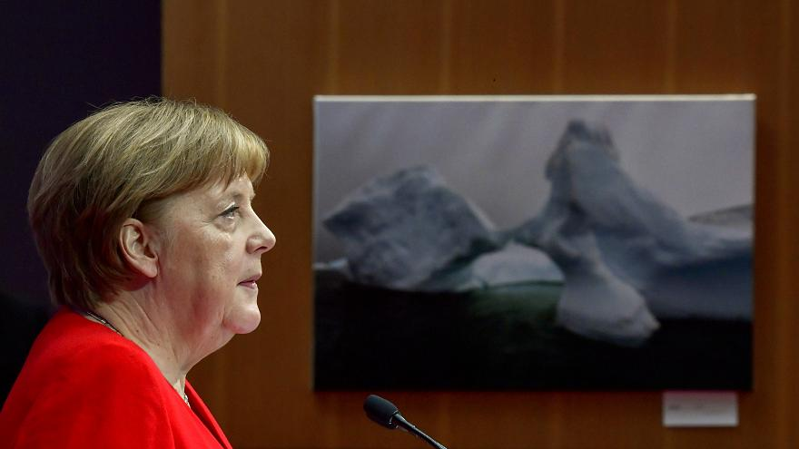 German Chancellor Angela Merkel delivers a spech at the start of the second day of the 10th Petersberger Klimadialog climate conference