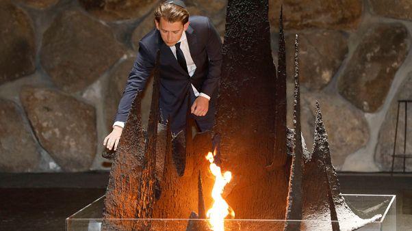 FILE PHOTO: Austrian Chancellor Sebastian Kurz rekindles the eternal flame during a Holocaust commemoration, Jerusalem, June 2018