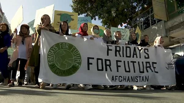 Troops protect people in Afghan climate protest