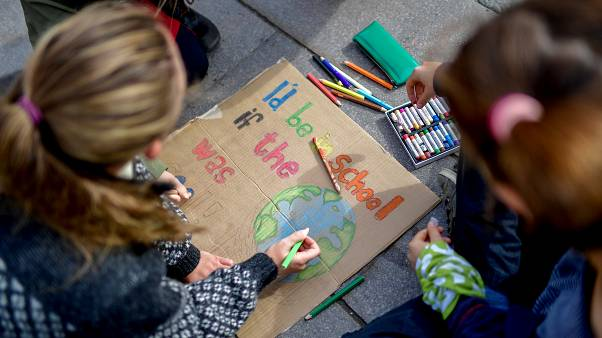Young activists paint placards during the Fridays for Future global climate strike in Stockholm, Sweden, September 20, 2019.
