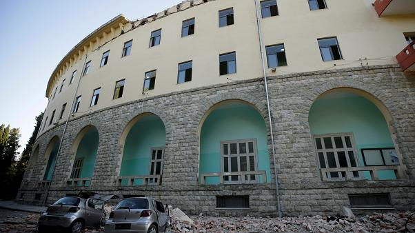 Destroyed cars stand next to a damaged building after an earthquake in Tirana, Albania, September 21, 2019.