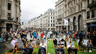 People relax on deck chairs on Regent Street after it was shut as part of 'Car Free Day' in London, Britain, September 22, 2019.
