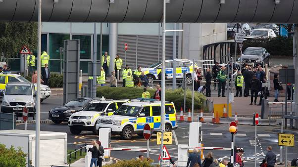 Police respond to an incident outside Manchester Airport