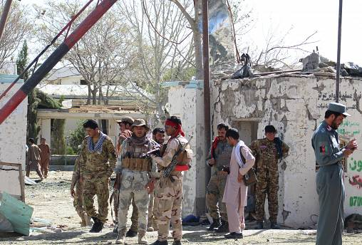 FILE PHOTO: Afghan security forces stand at the site of a car bomb attack in Qalat, capital of Zabul province, Afghanistan September 19, 2019.