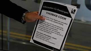 A man holds information on Thomas Cook flights at Manchester Airport, Manchester, Britain September 23, 2019.