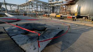 FILE PHOTO: A metal part of a damaged tank is seen at the damaged site of Saudi Aramco oil facility in Abqaiq, Saudi Arabia, September 20, 2019.