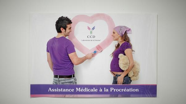 A poster promoting medical assistance for procreation is displayed in the lobby of the Laboratory of Reproductive Biology CECOS of Tenon Hospital in Paris, France