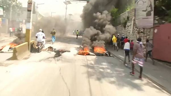 Clashes continue in Haiti after senator fires pistol