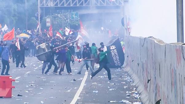 Police fire water canons as Indonesians rally against new penal code