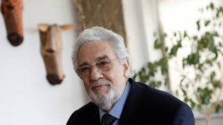 Opera singer Placido Domingo sits during an event at the Manhattan School of Music in New York