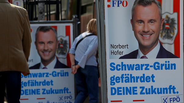 Persons pass election campaign posters of the head of Austria's Freedom Party (FPO) Norbert Hofer in Vienna, Austria September 23, 2019.