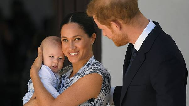 Britain's Prince Harry and his wife Meghan, Duchess of Sussex, holding their son Archie, meet Archbishop Desmond Tutu (not pictured)