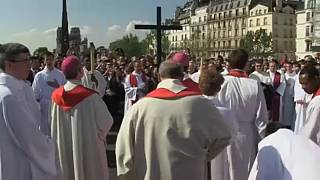 Emotional Notre-Dame cathedral Way of the Cross ceremony on Good Friday